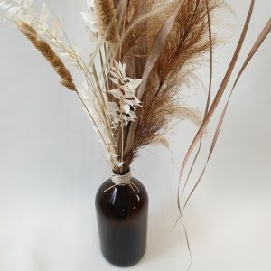 brown bottle dried arrangement